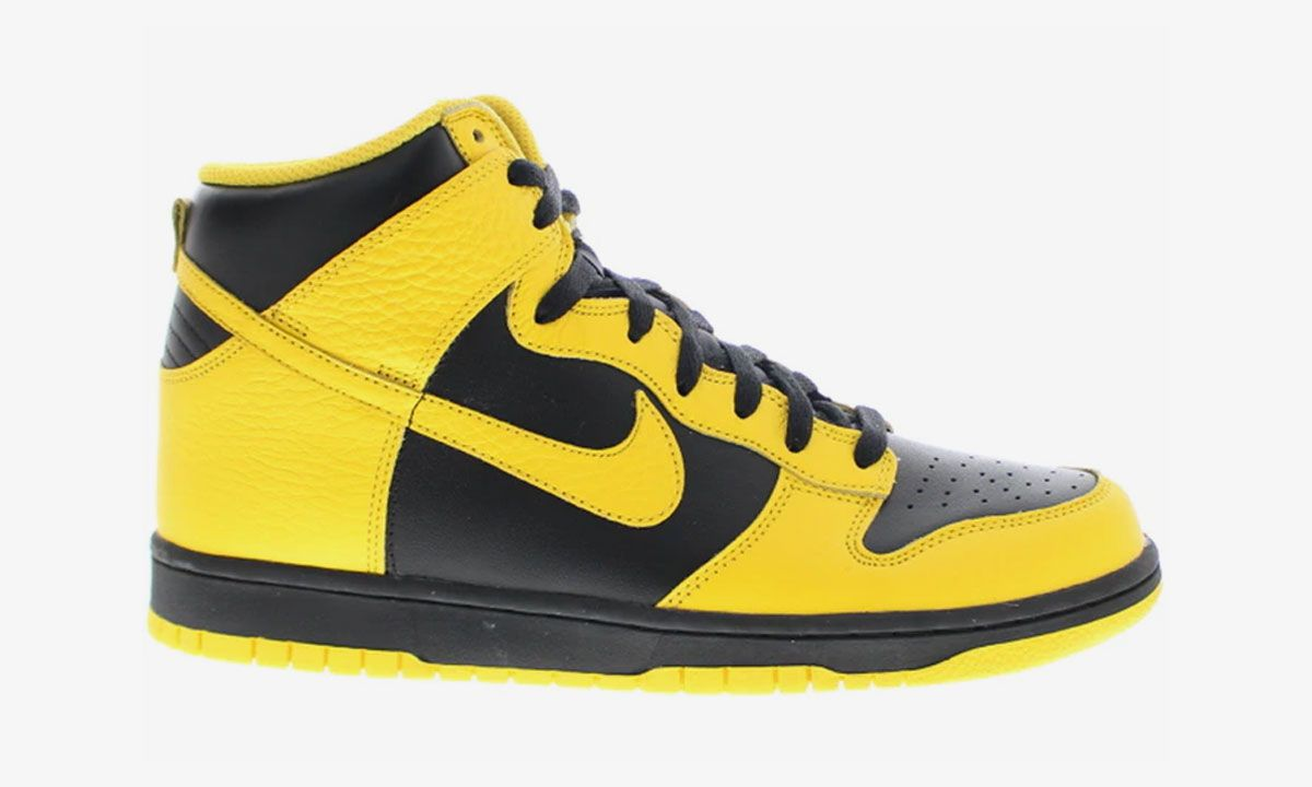 black and yellow Nike Dunk High product shot side view