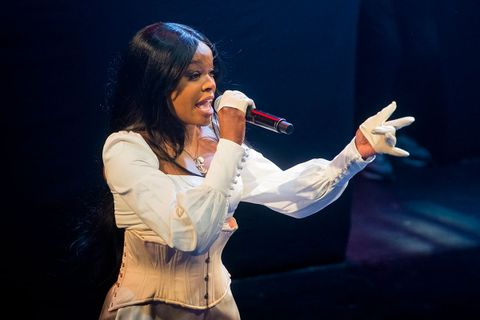 Azealia Banks performs onstage in white outfit