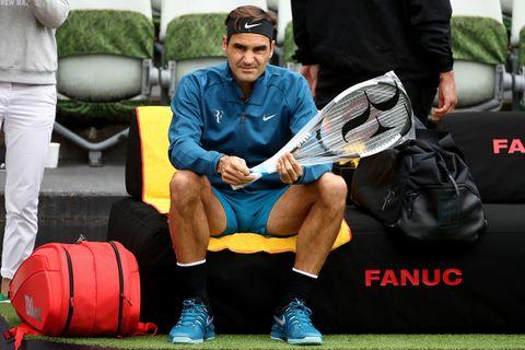 Roger Federer Nike gear tennis racquet