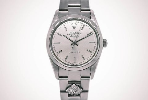 48accc4bec7 This Is the Inside Story Behind the Bizarre Domino s Rolex