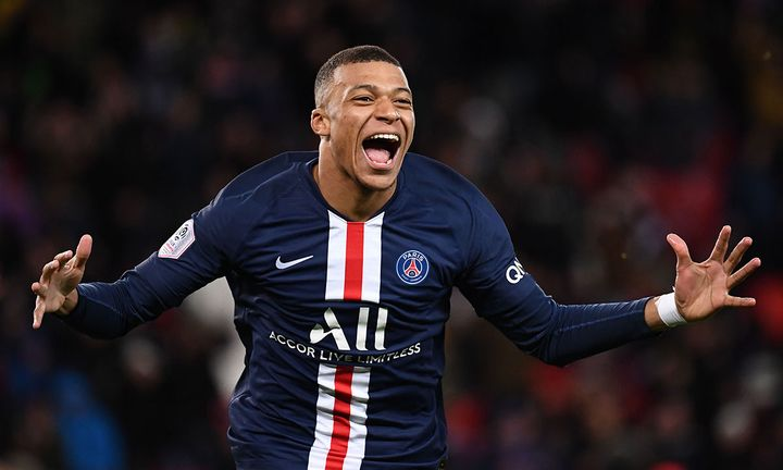 Paris Saint-Germain's French forward Kylian Mbappe celebrates after scoring a goal during the French L1 football match between Paris Saint-Germain (PSG) and Dijon