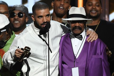 Drake and father Dennis Graham accepting award