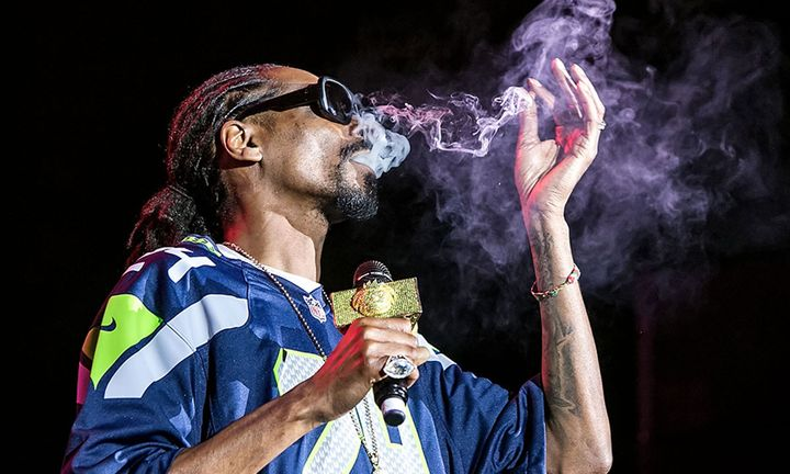 Snoop Dogg smokes a blunt on stage