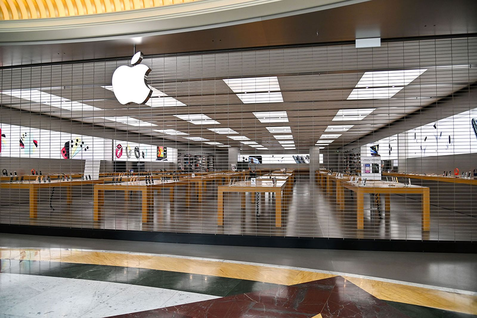 A closed Apple Store is pictured in a deserted EUROMA2 shopping mall