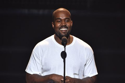 Kanye West smiling white tee