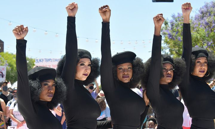 Activists raise their fists in solidarity at the All Black Lives Matter Solidarity March in LA