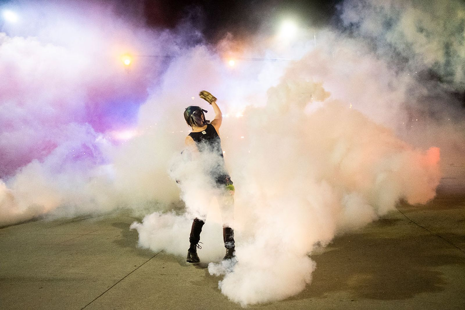 Protestor With Gas Cannister