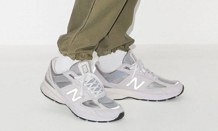 reflective grey New Balance 990v5 on foot