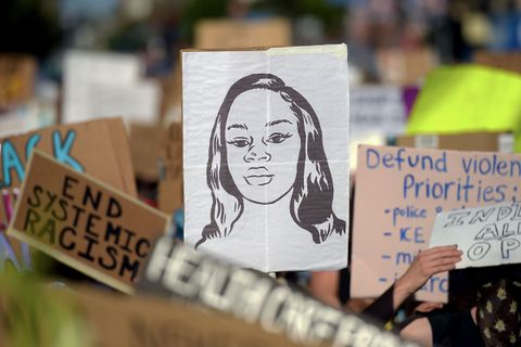 Breonna Taylor sign in protest crowd