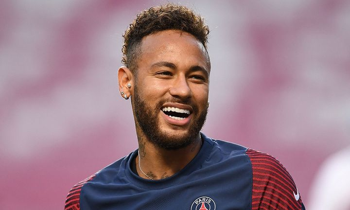 Paris Saint-Germain's Brazilian forward Neymar laughs during a training session at the Luz stadium in Lisbon