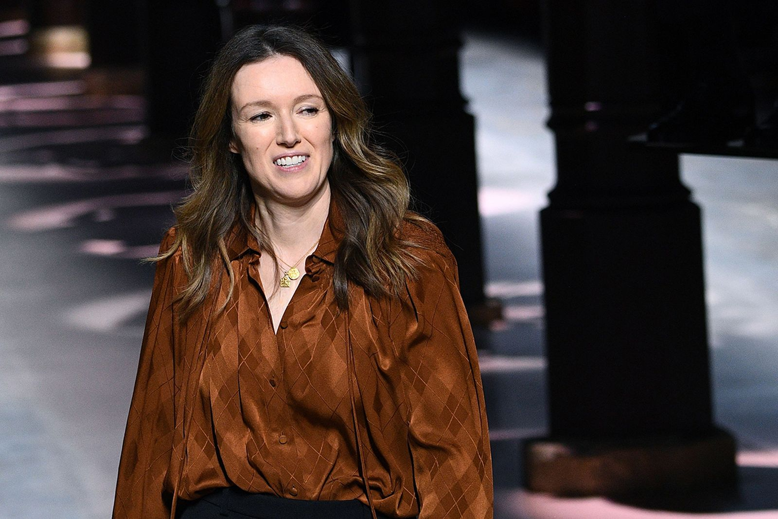 Clare Waight Keller, acknowledges the audience at the end of the Women's Spring-Summer 2020