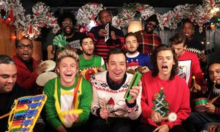 """Watch One Direction, The Roots & Jimmy Fallon Perform """"Santa Claus is Coming to Town"""" Using Children's Instruments"""