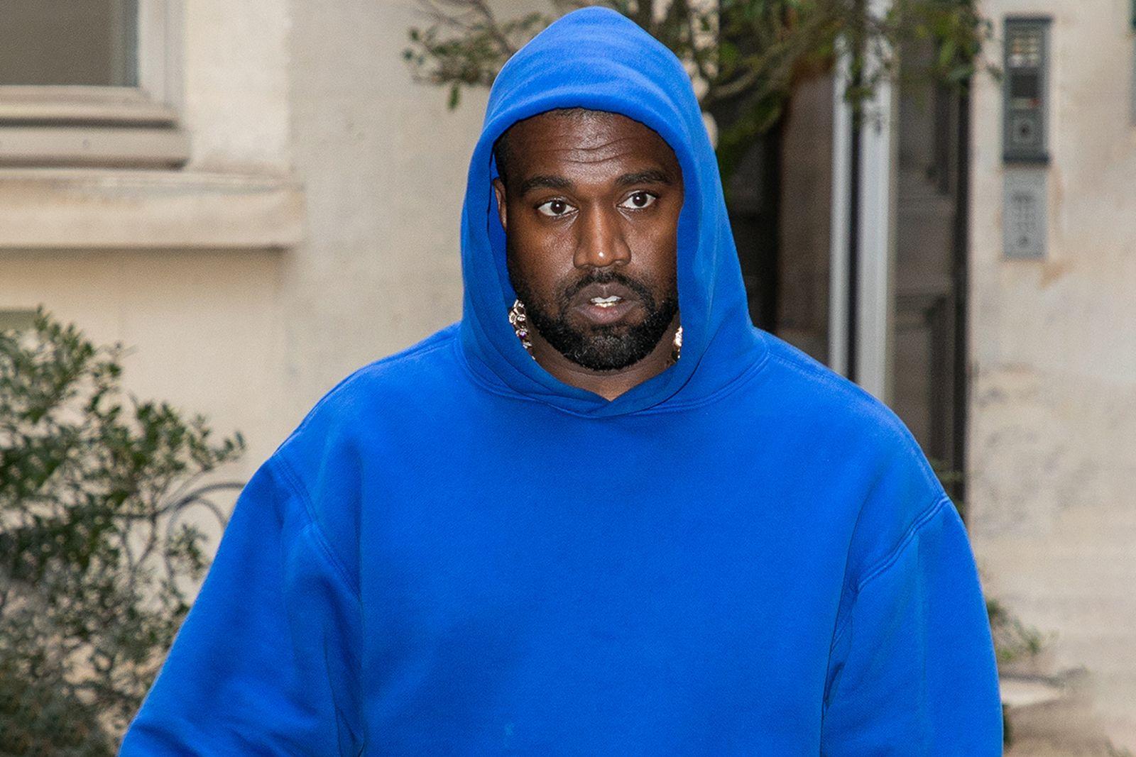 Kanye West dons a blue hoodie in Paris