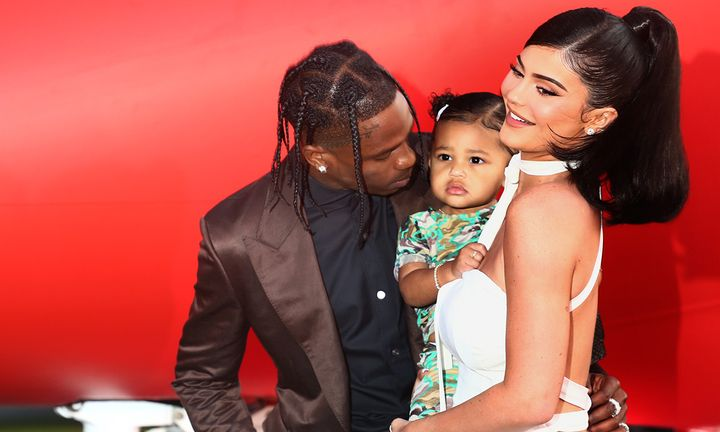 Travis Scott, Kylie Jenner and daughter Stormi attend premier