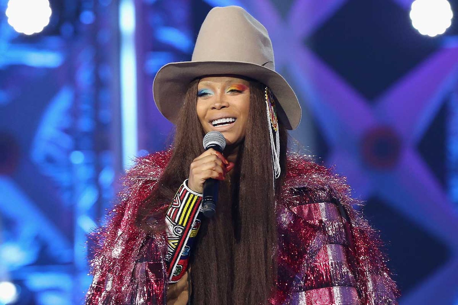 Erykah Badu performing on stage