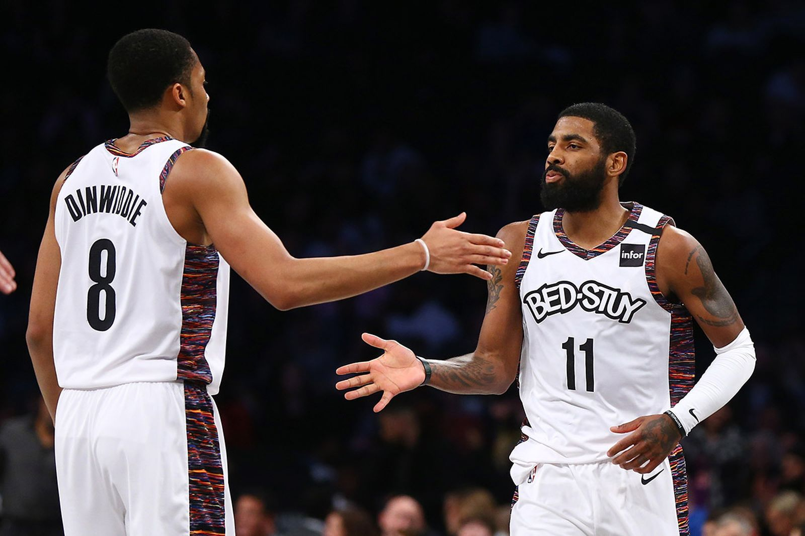 Kyrie Irving #11 of the Brooklyn Nets celebrates with Spencer Dinwiddie #8