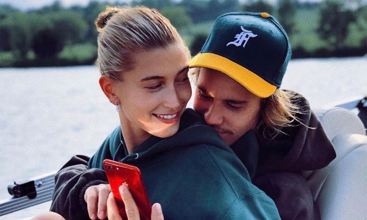 Justin Bieber Hailey Bieber on a boat looking at red phone