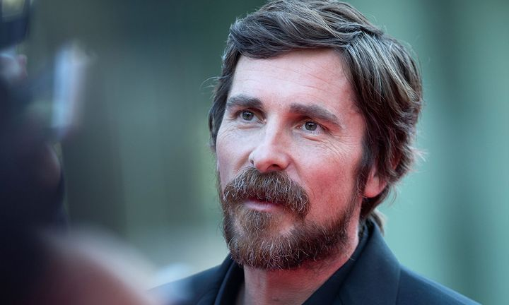 Christian Bale close-up face red carpet