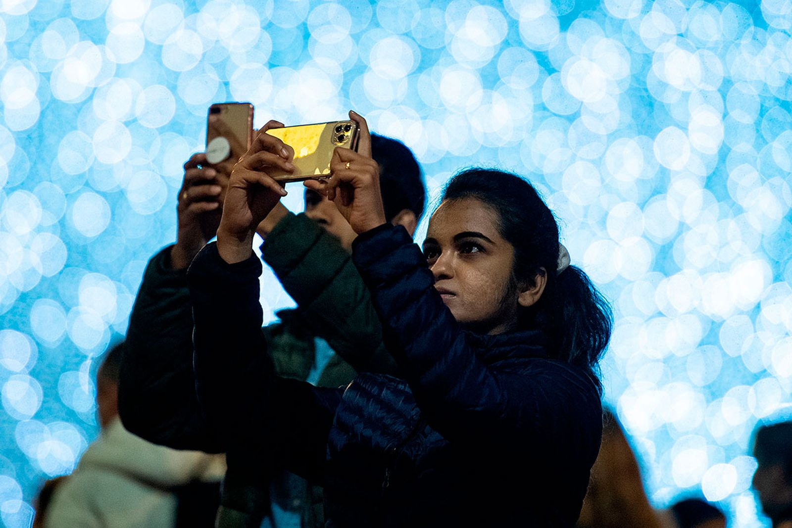Woman takes photo with iPhone