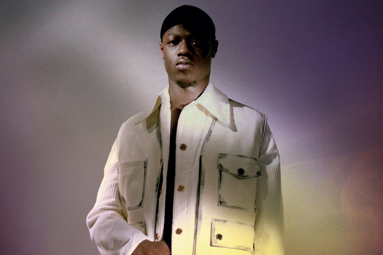 J Hus white jacket