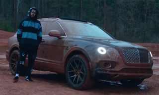 "J. Cole Takes a Bentley Off Road in ""Middle Child"" Video"