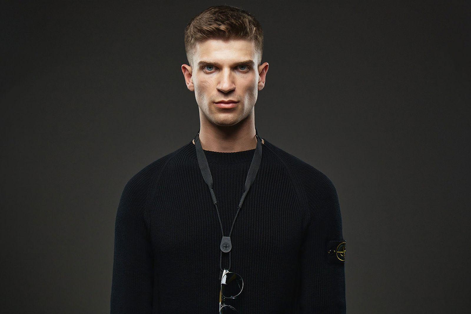 Model wears Persol x Stone Island Pilot Frame