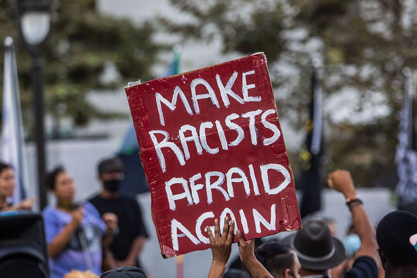 BLM protestor banner