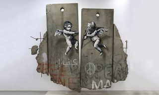 """Banksy Is Handing out """"Free Palestine"""" Posters at London's World Travel Market"""
