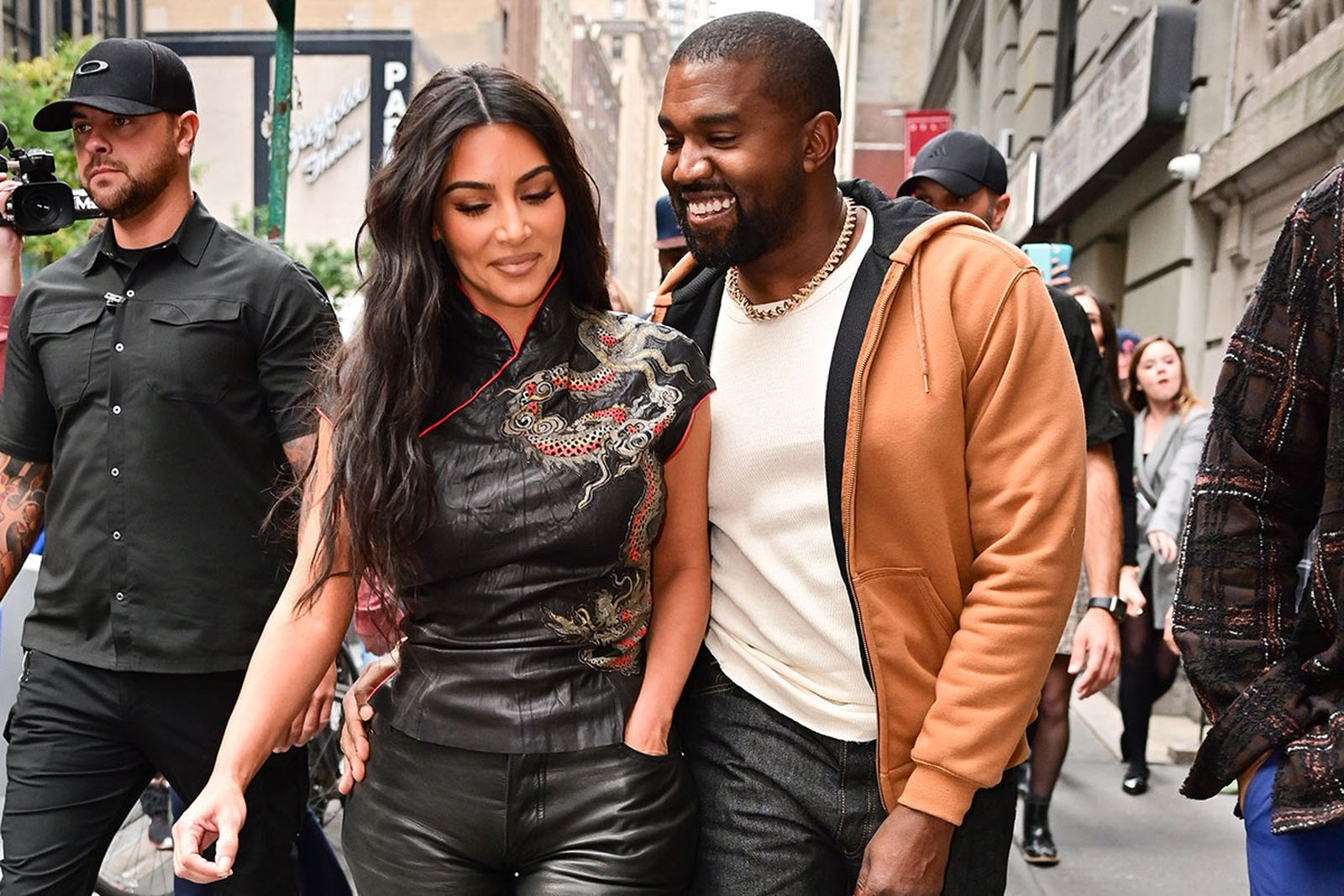 Kim Kardashian and Kanye West smiling walking together