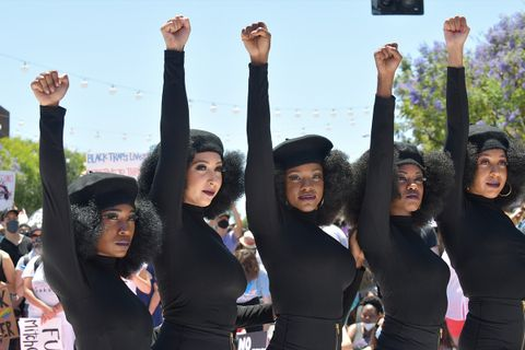 : Activists raise their fists in solidarity at the All Black Lives Matter Solidarity March in LA