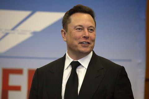 Elon Musk suit tie smiling