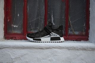 best service 69e1a 0a7d2 Louis Vuitton Print Takes Over These Custom Human Race NMDs