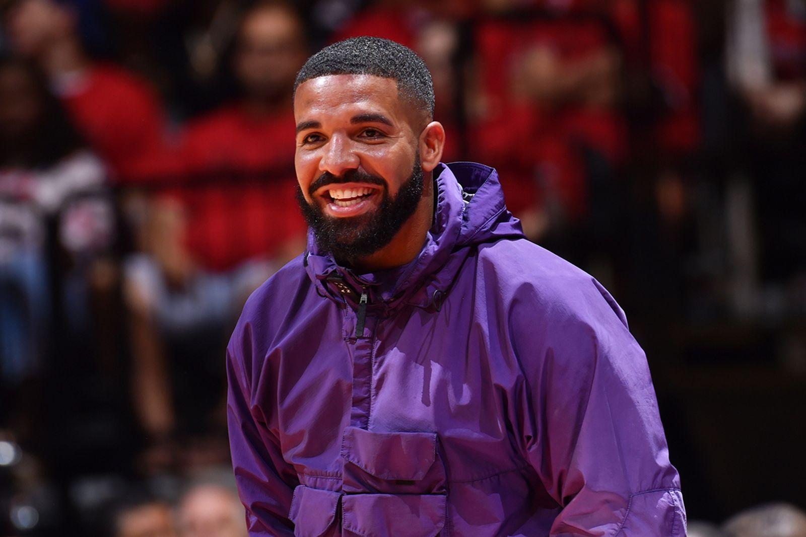 Drake smiling purple jacket