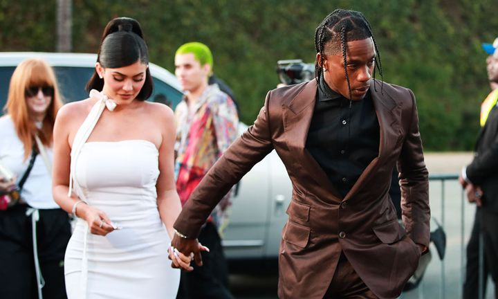 Travis Scott and Kylie Jenner hold hands