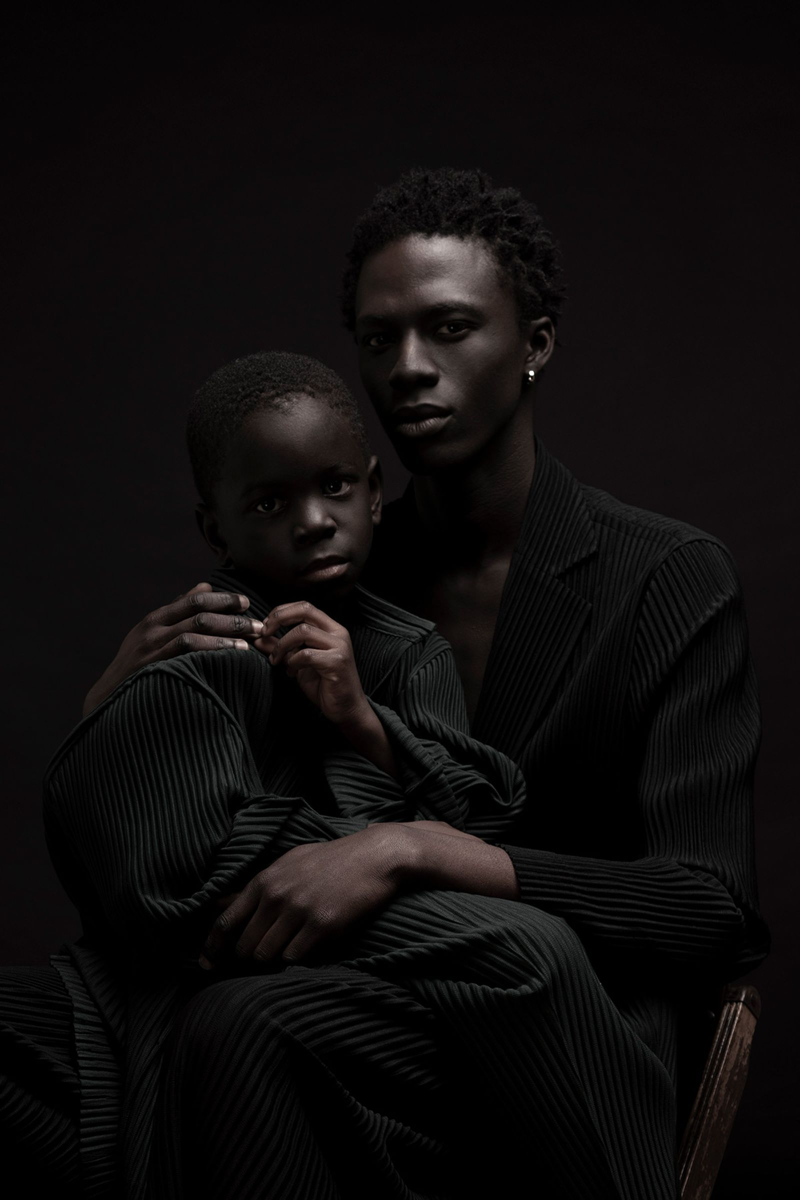 Cherif and Cheritha are wearing Full Looks - Homme Plissé Issey Miyake