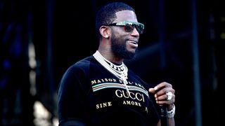 Gucci Mane performing Gucci shirt