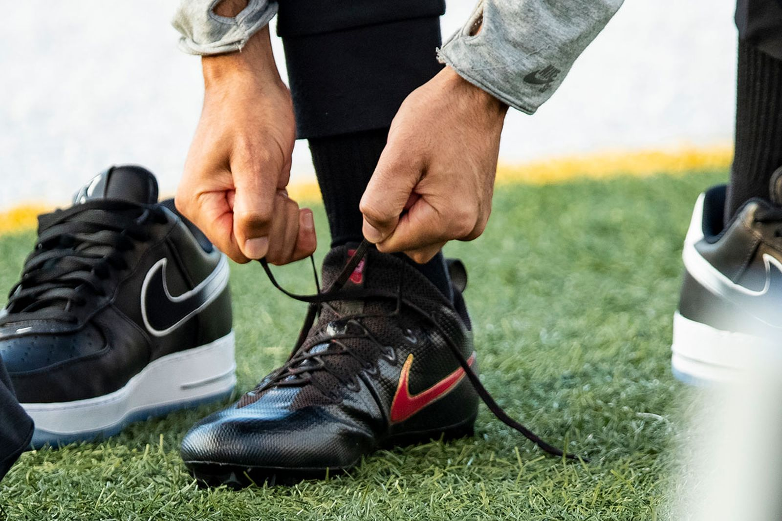 Colin Kaepernick laces cleats next to rummer Nike AF1 collab