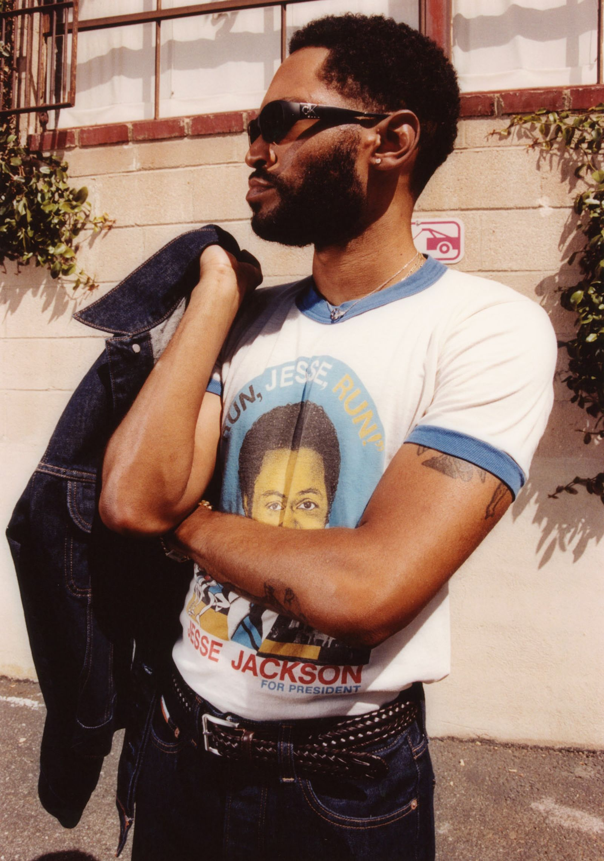 Jacket, jeans and sunglasses HERON PRESTON FOR CALVIN KELIN Vintage shirt BLK MKT VINTAGE Ring and necklace CARTIER Ring and bracelet DAVID YURMAN Belt STYLIST'S OWN