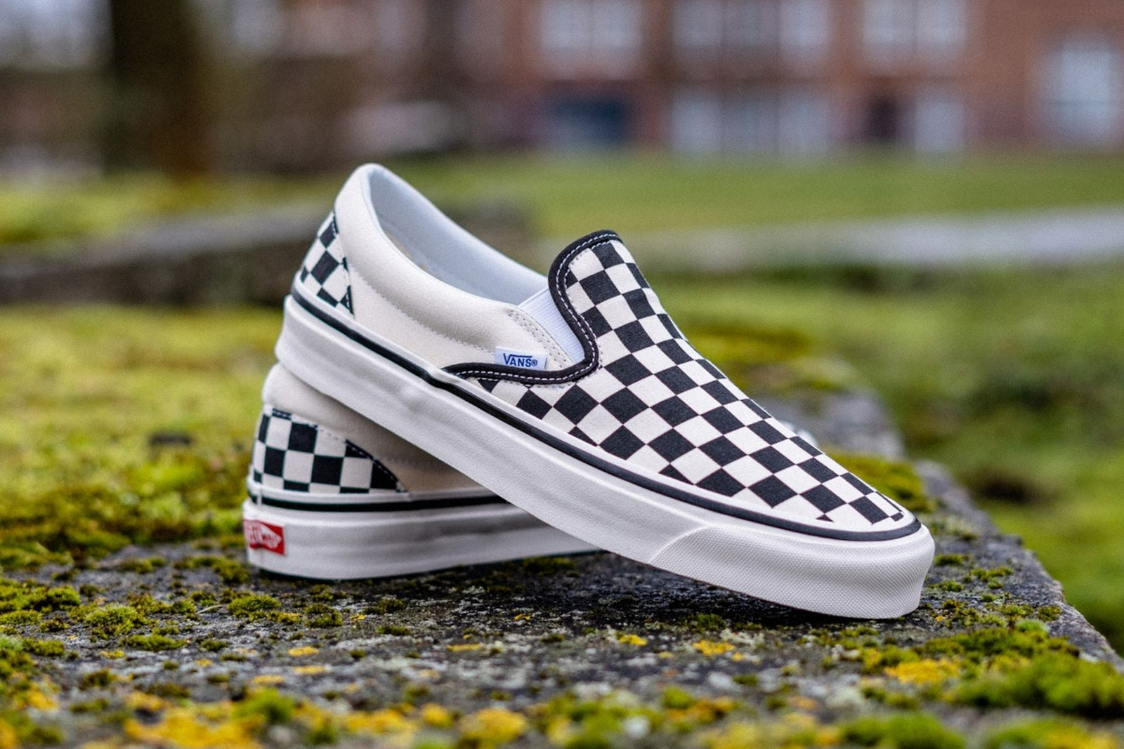black and white checkerboard Vans slip on product shot side view