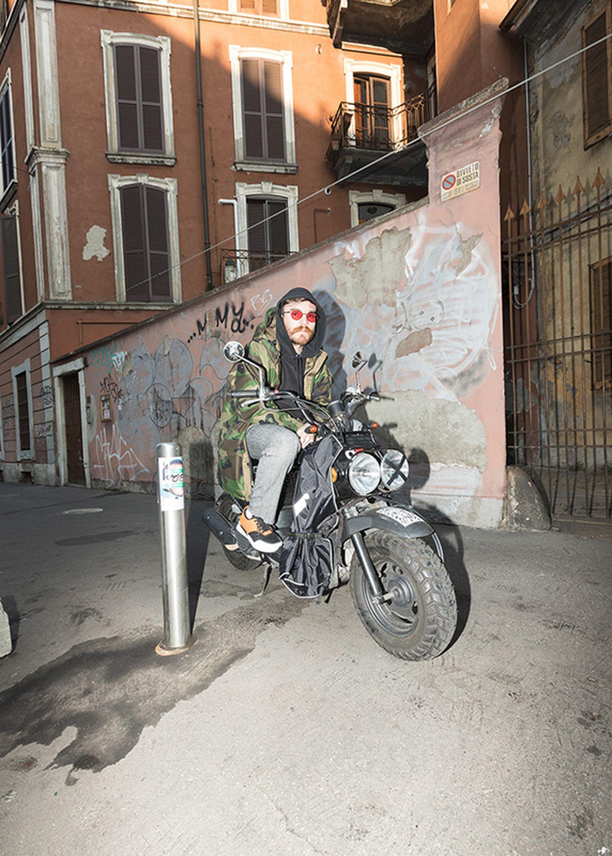 Alberto Panocchi wears Matteo Lamandini Studio pants, a Fuct sweatshirt and a vintage military parka.