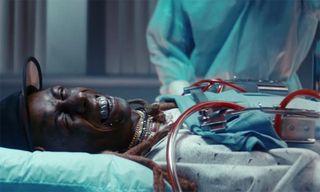 "Lil Wayne Goes Under the Knife in 2 Chainz's Bizarre ""2 Dollar Bill"" Video"
