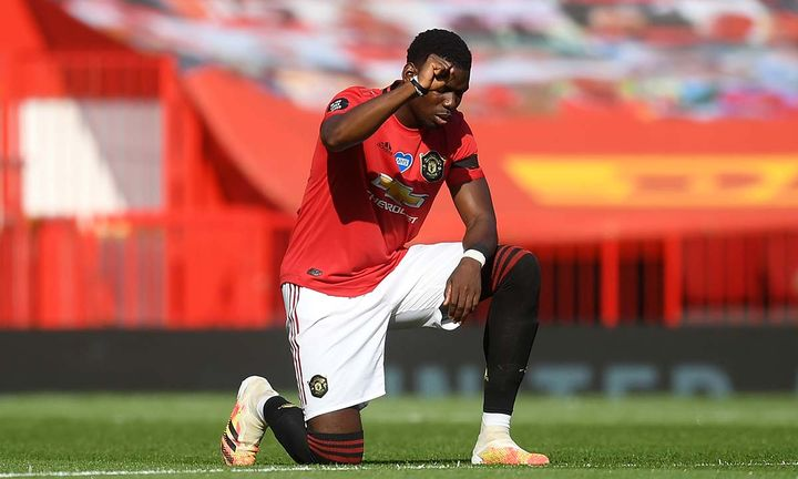 Paul Pogba of Manchester United takes a knee in support of the Black Lives Matter movement