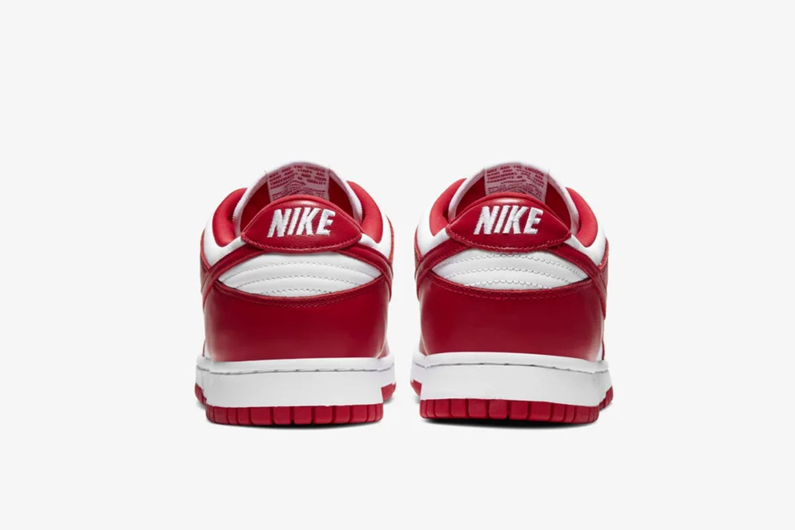 Red and white Nike Dunk Low side view