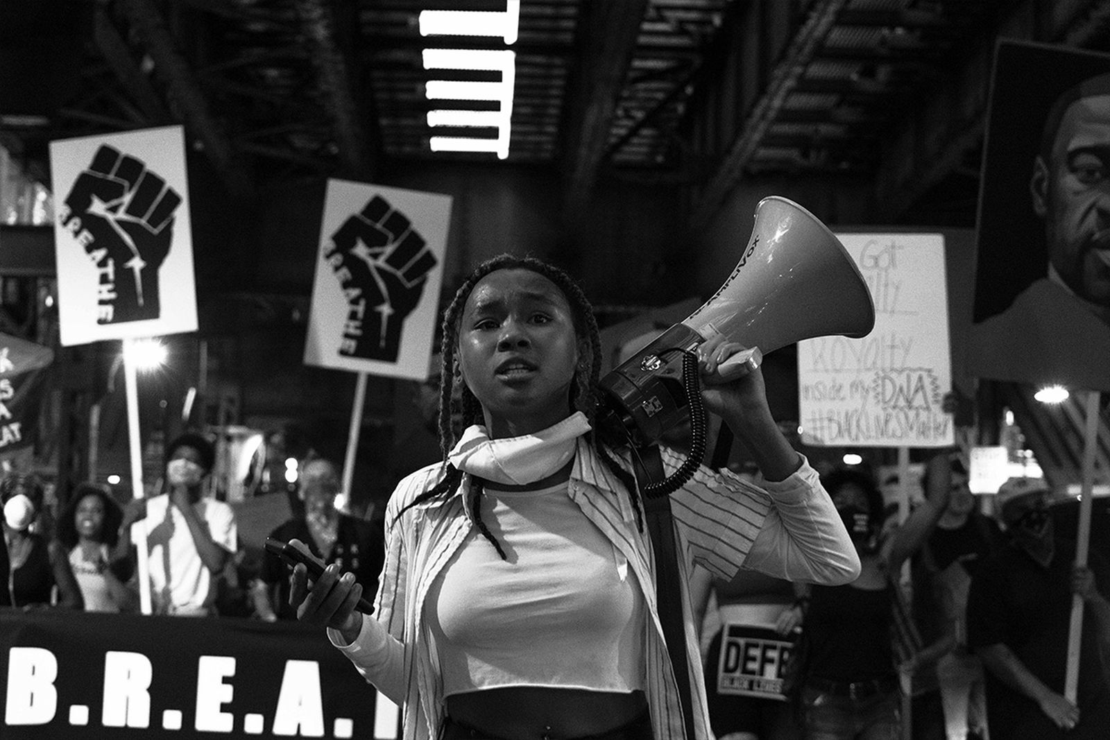 Woman holding loudspeaker