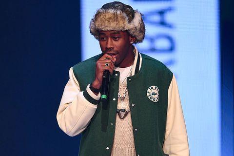 Tyler the creator wearing Golf le Fleur varsity jacket and Igor chain