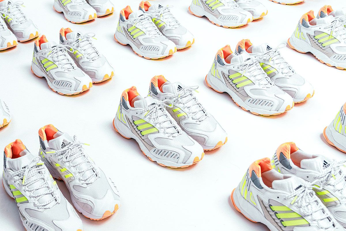dozens of pairs of solebox x adidas torsion trdc sneakers on the floor