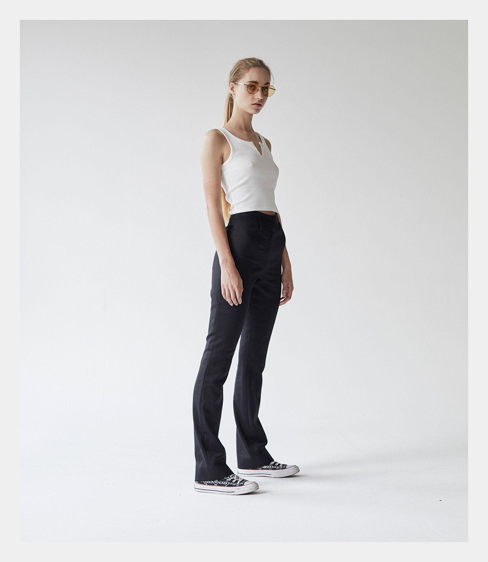 Vest: WEEKDAY. Trouser: STEVE O'SMITH. Sneakers: CONVERSE x J.W. ANDERSON. Sunglasses: MYKITA STUDIO.