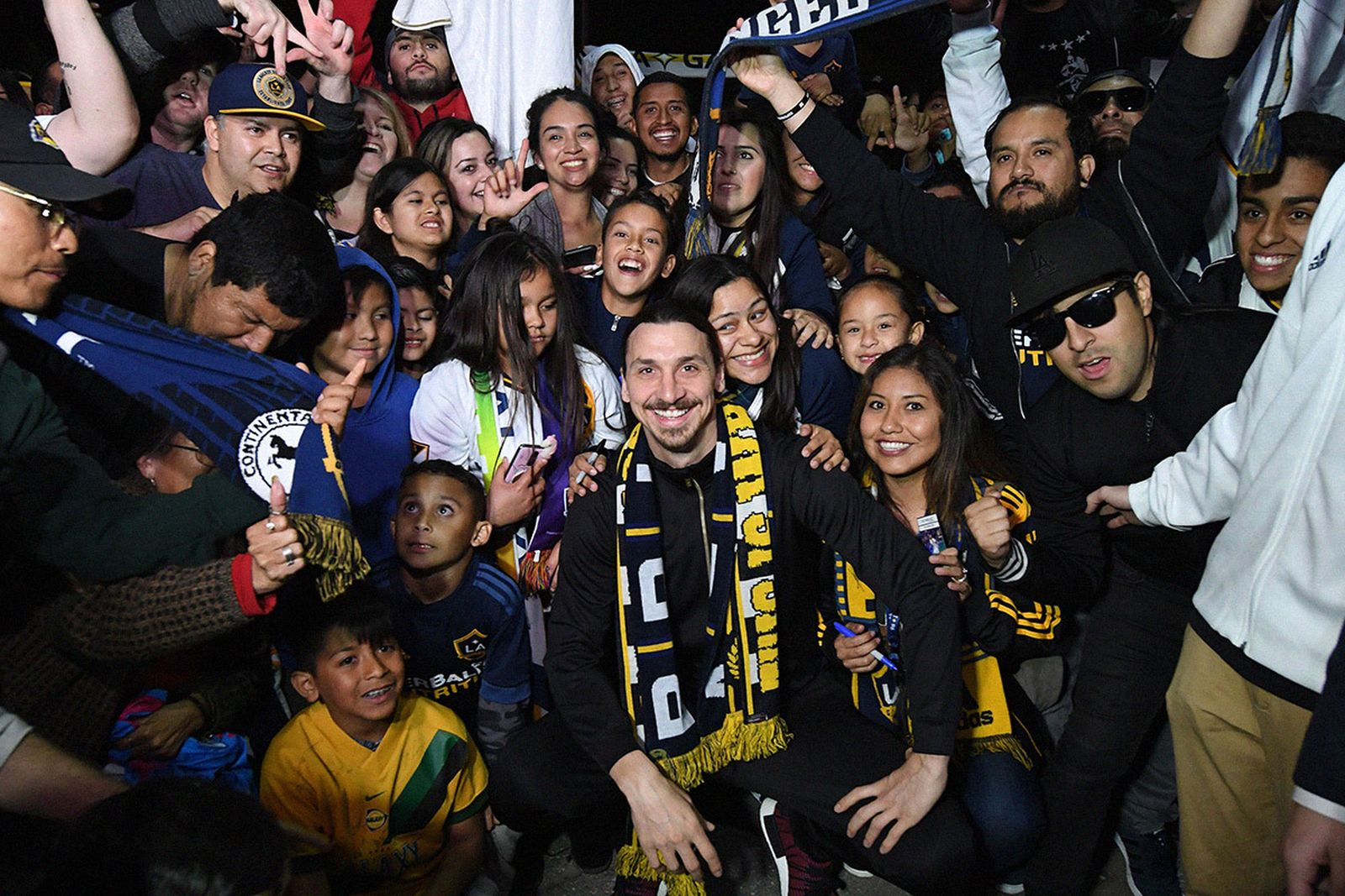 Zlatan Ibrahimovic is greeted by fans after arriving at Los Angeles International Airport to begin his new contract with LA Galaxy in Los Angeles, California.
