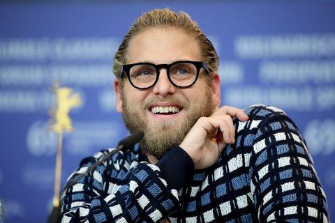 Jonah hill glasses smiling blue background