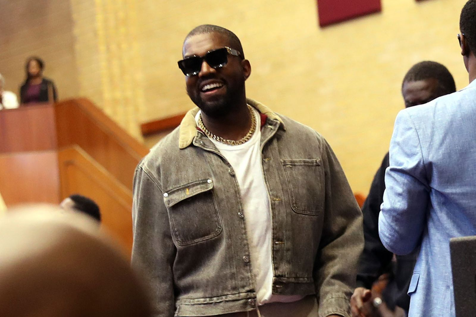 Kanye West smiling wearing shades